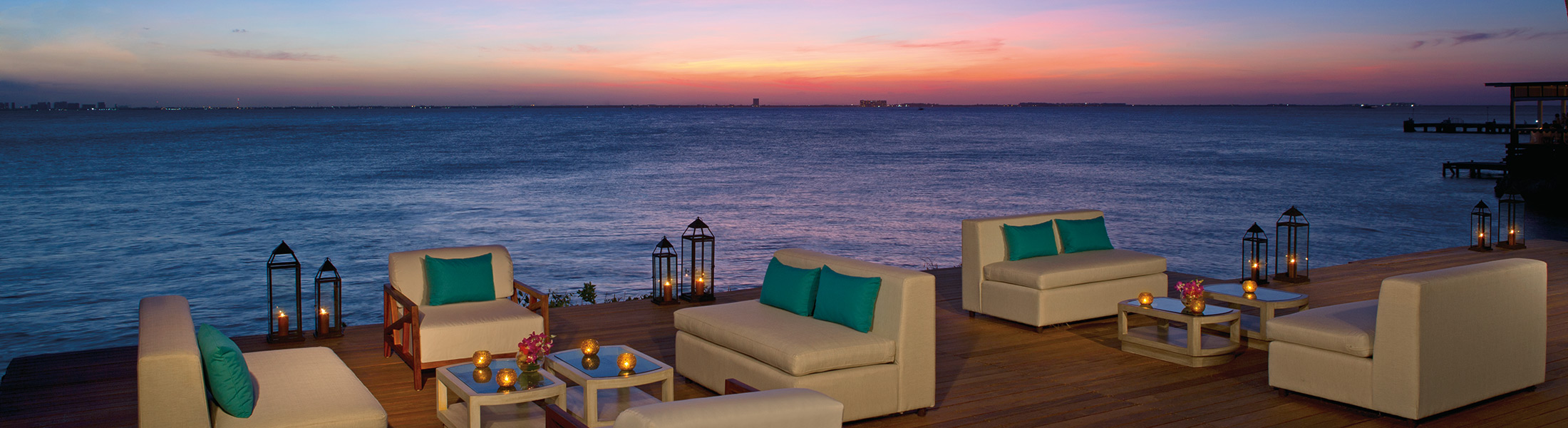 Sunset dining on the outdoor deck at Zoetry Villa Rolandi Isla Mujeres