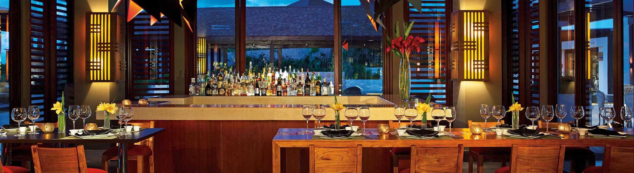 Sushi bar at night at Secrets Playa Mujeres