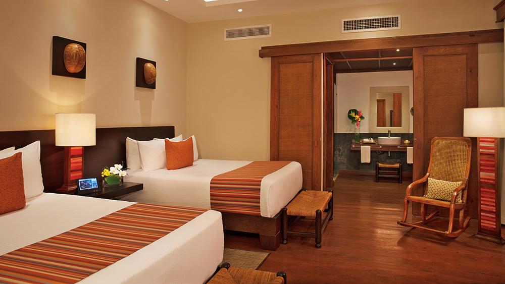 Twin bedroom of the Villa Dominica at Zoetry Agua Punta Cana