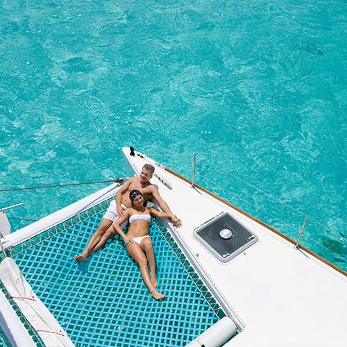 Couple relaxing on a catamaran at Zoetry Paraiso de la Bonita