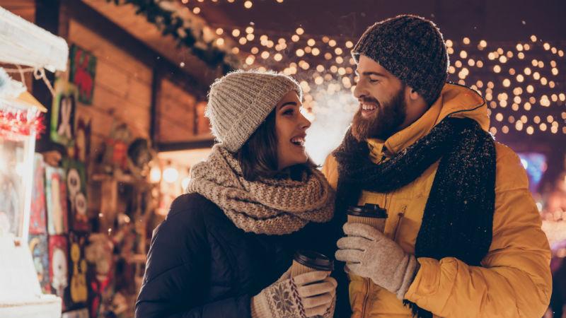 couple walking through Christmas Market