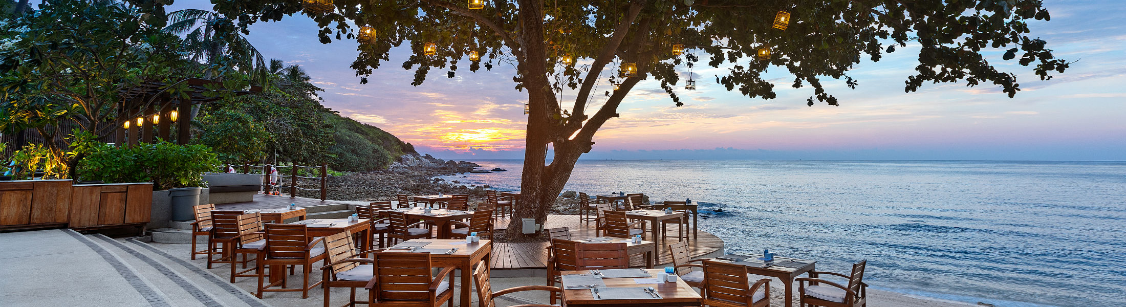Outdoor dining at sunset at Outrigger Koh Samui Beach Resort