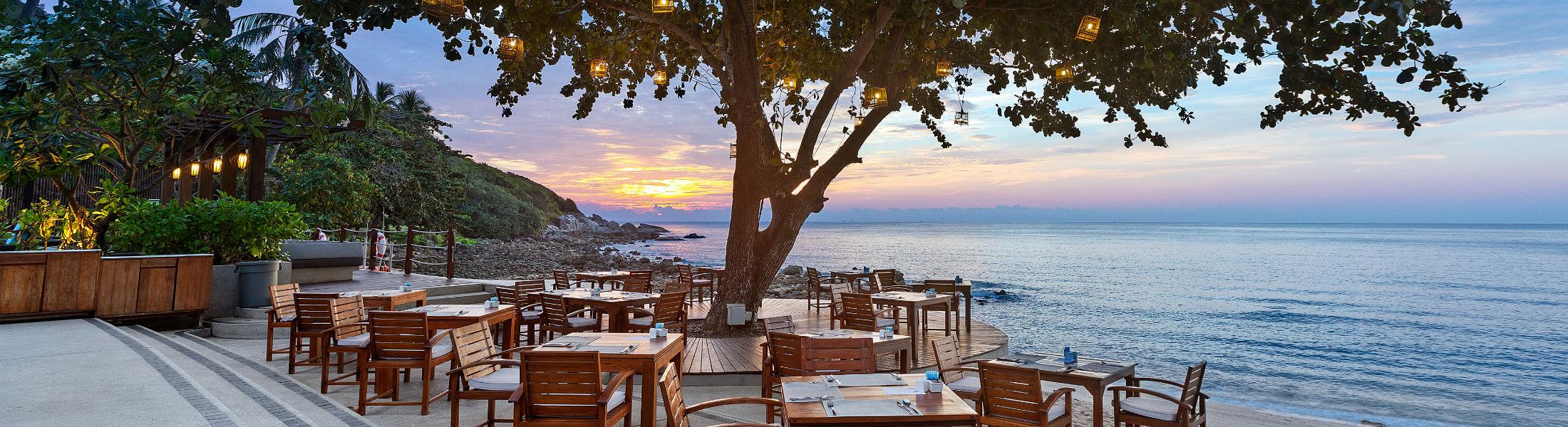 Outdoor dining at sunset at Outrigger Koh Samui Beach Resort