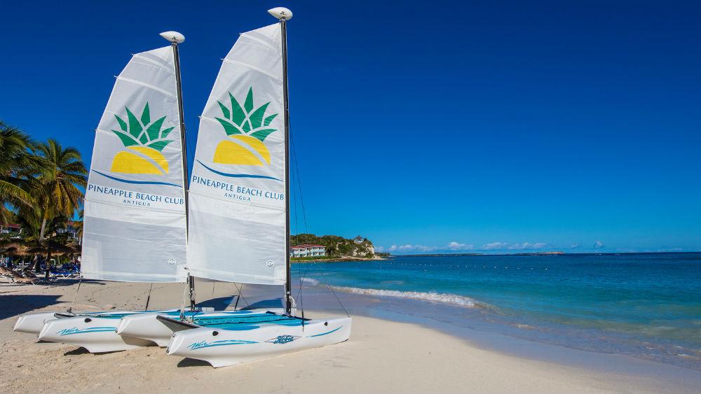 sail boats on the beach at the Pineapple Beach Club, Antigua