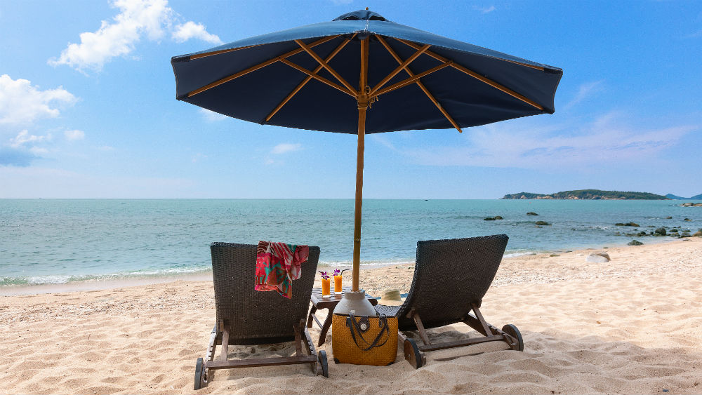 sun loungers on the beach at the Outrigger koh samui beach resort