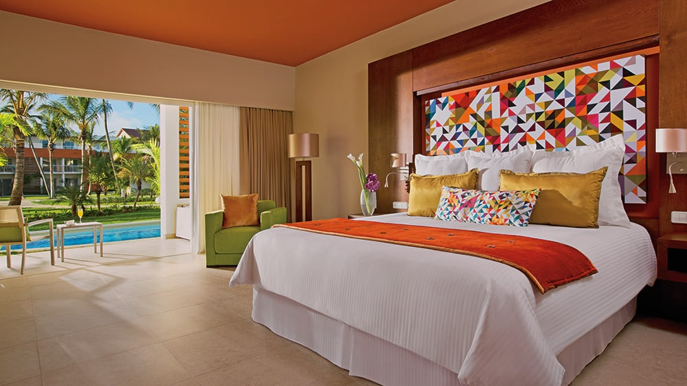 Bedroom of the Allure Junior Suite Swim-up at Breathless Punta Cana