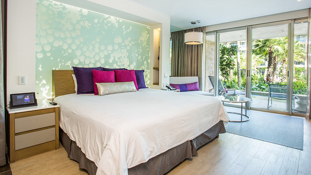 Bedroom of the Allure Junior Suite Swimout Tropical View at Breathless Riviera Cancun