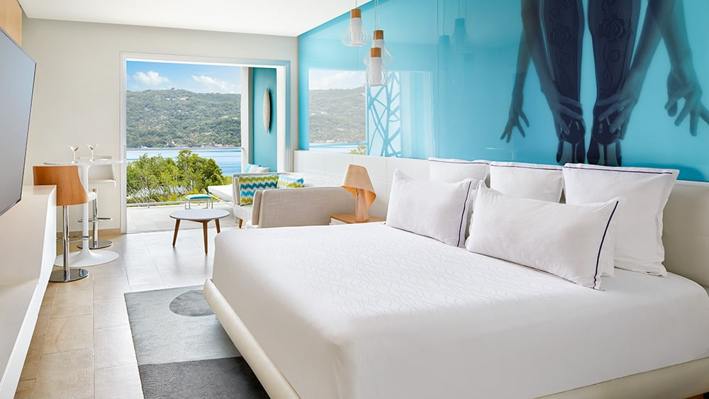 Bedroom of the Allure Junior Suite Tropical View at Breathless Montego Bay