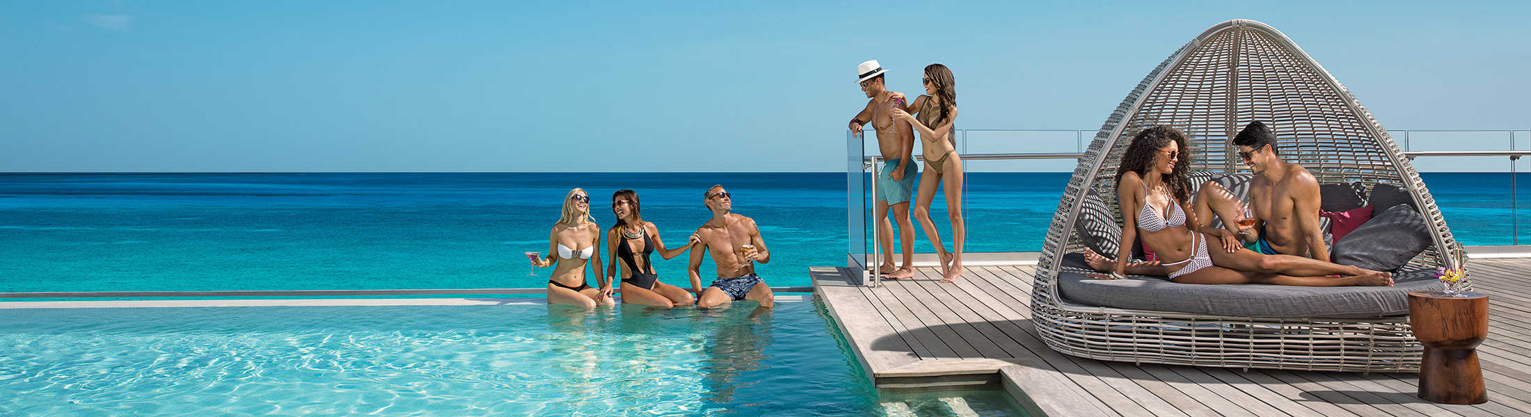 Friends and couples relaxing in the infinity pool at Breathless Montego Bay