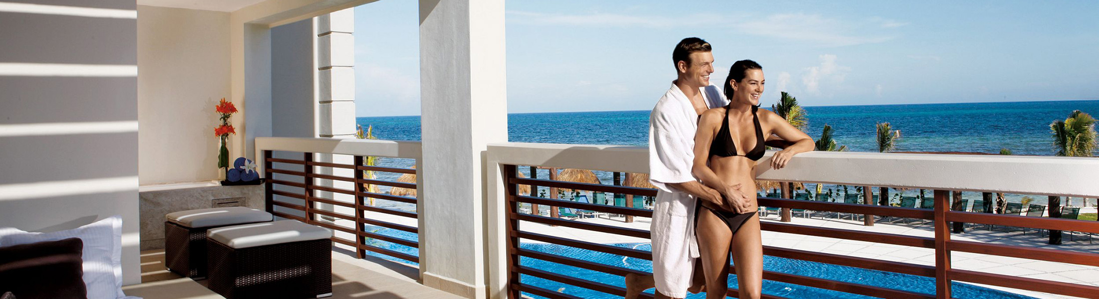 Couple on the balcony overlooking the ocean