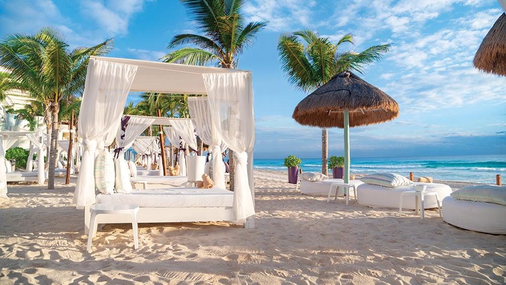 Beach cabanas and sun loungers at Now Emerald