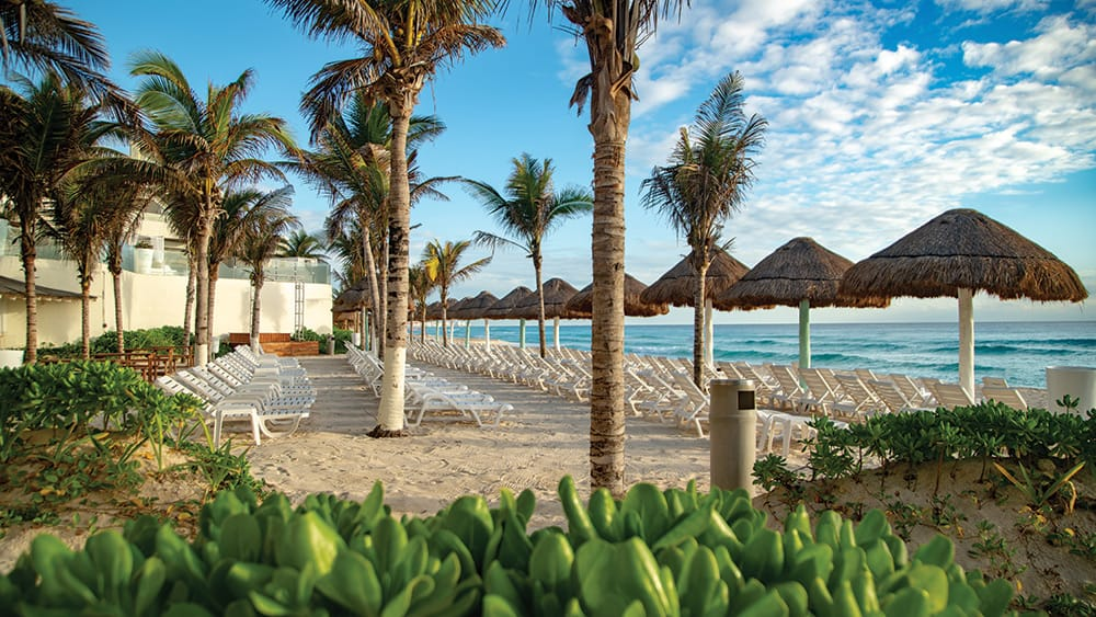 Sun loungers on the beach at Now Emerald