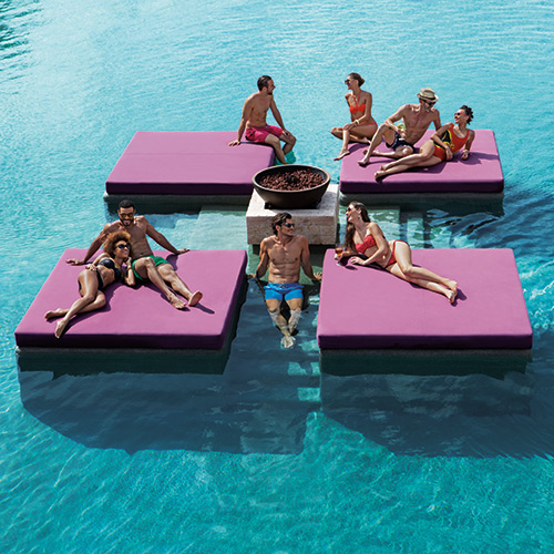 Friends on pontoons in the pool at Breathless Riviera Cancun