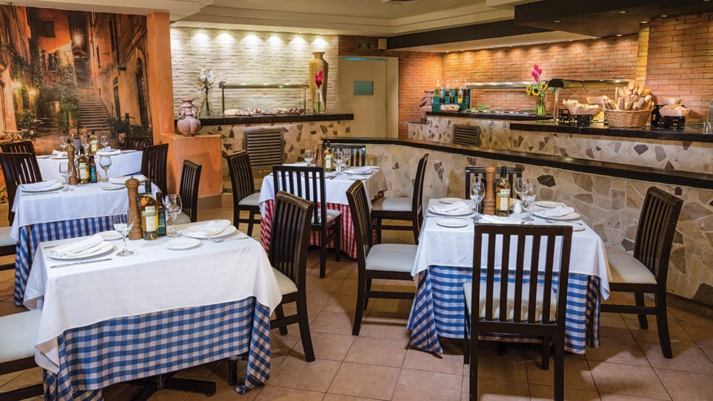 Dining tables in Capers restaurant at Now Emerald
