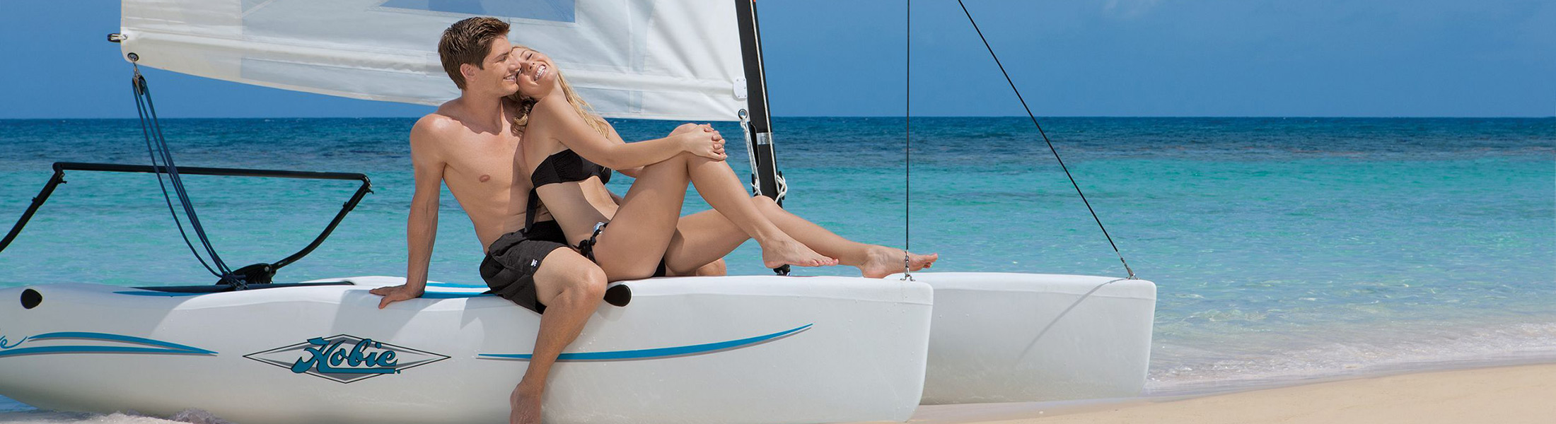 Couple relaxing on a catamaran at Secrets St James