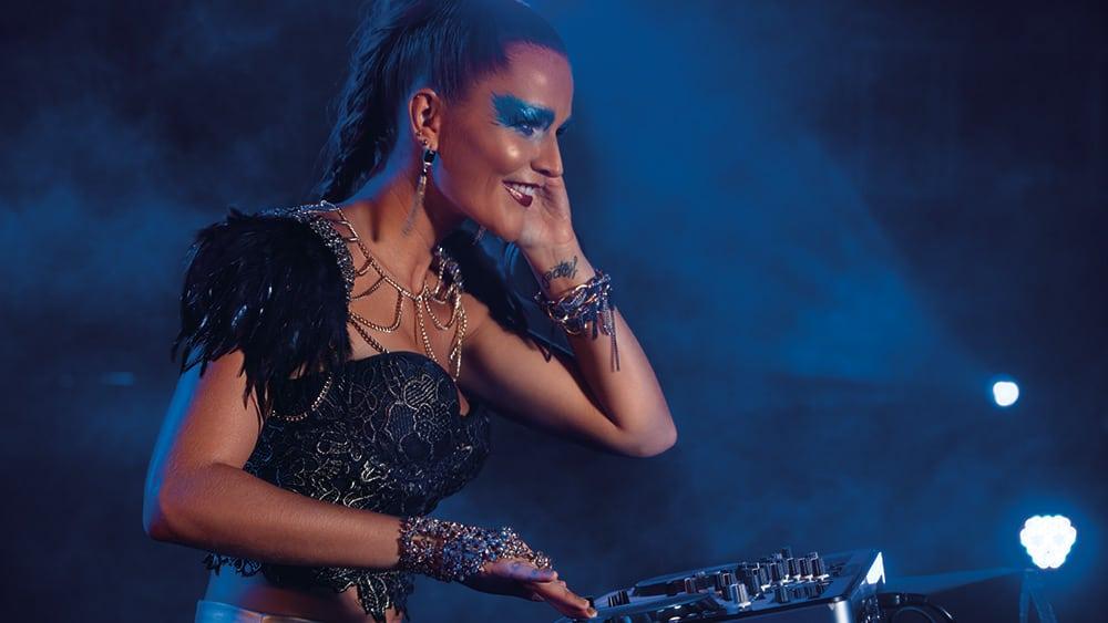 Woman DJing at night at Breathless Riviera Cancun