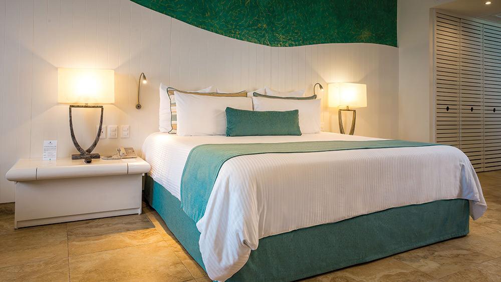 Bedroom of the Deluxe garden View room at Now Emerald