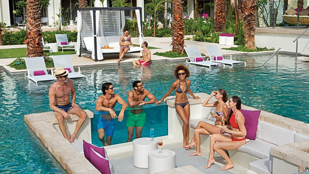 Friends in and around the Energy Pool at Breathless Riviera Cancun