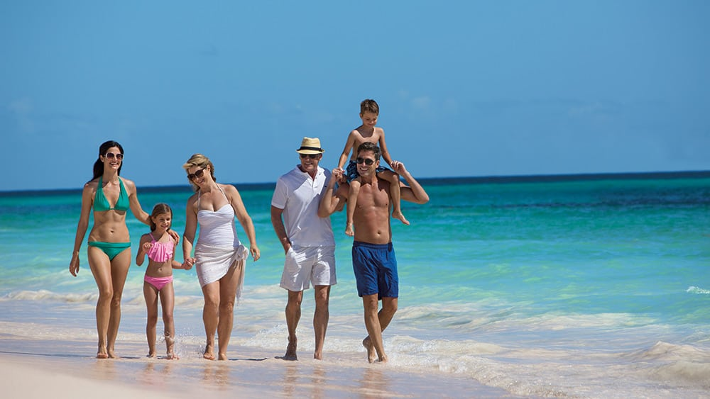 Family on the beach at Now Emerald