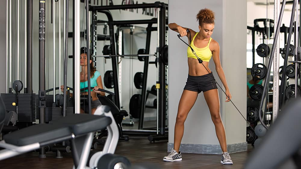 Women using gym equipment in the Fitness Centre at Breathless Riviera Cancun