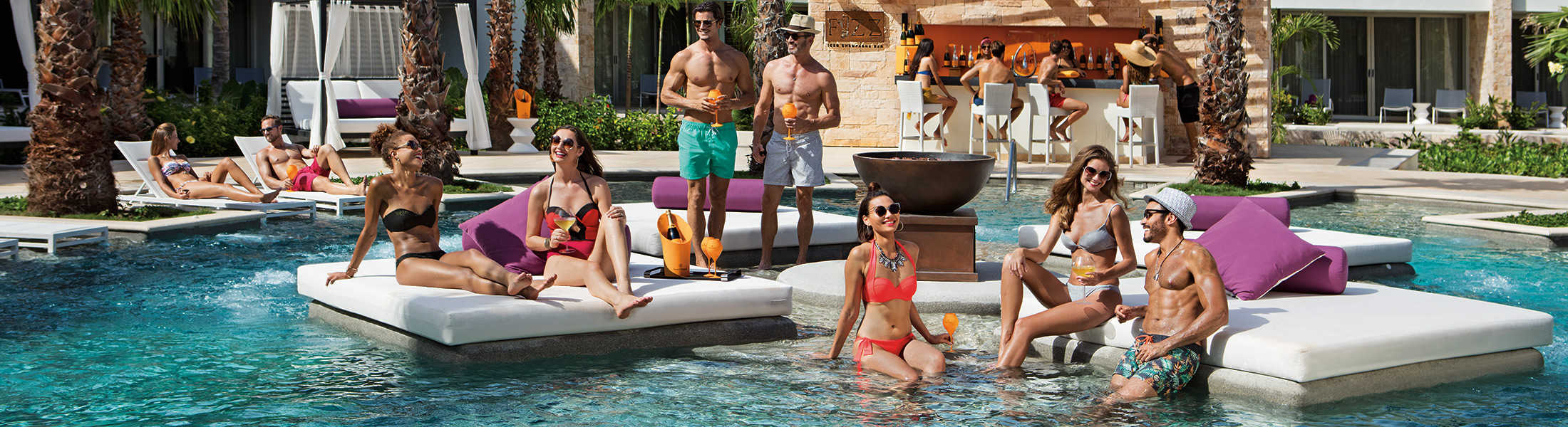 Adults relaxing in the pool at Breathless Riviera Cancun