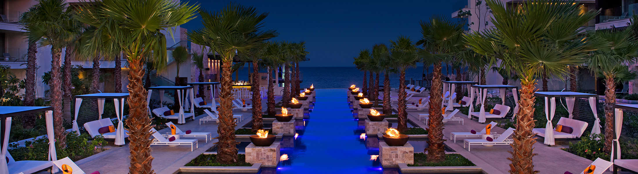 The freestyle pool at night at Breathless Riviera Cancun