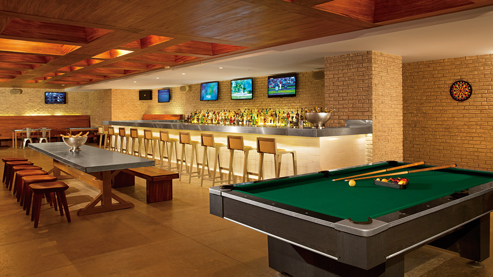 Sports bar with pool table at Secrets The Vine