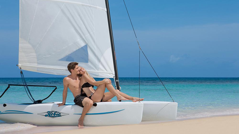 Couple on a catamaran at Secrets St James