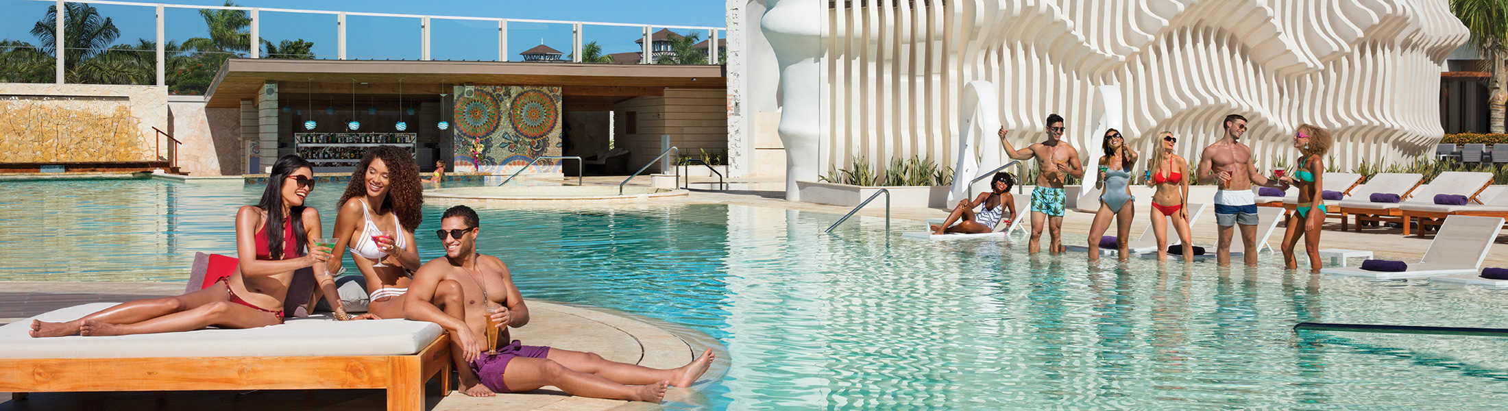 Couples and friends relaxing in the main pool at Breathless Montego Bay