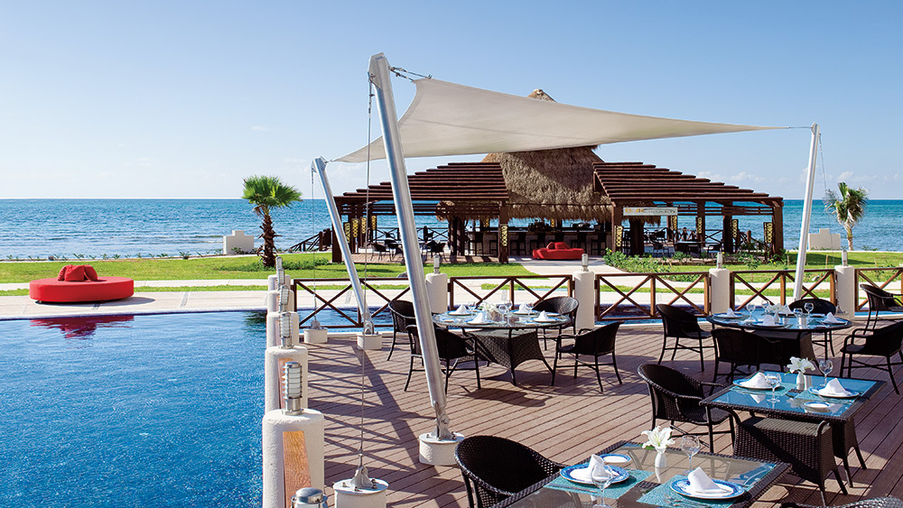 Outdoor dining area at Oceana Restaurant at Secrets Silversands Riviera