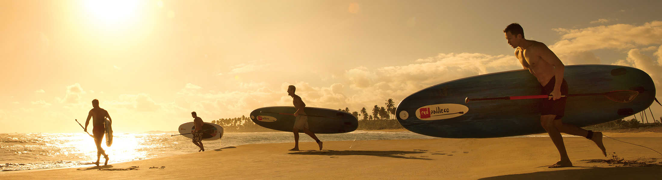 Men with paddleboards at Breathless Punta Cana