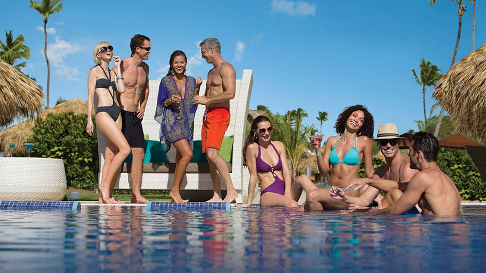 Friends around the pool at Breathless Punta Cana
