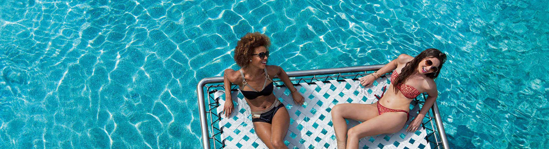 Woman relaxing on a net over the pool at Breathless Riviera Cancun