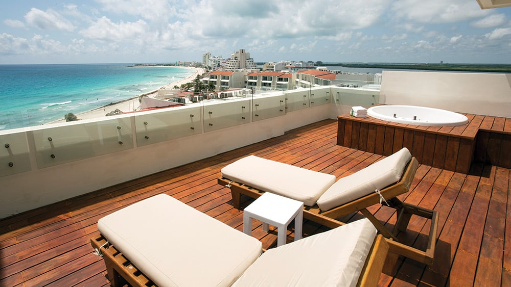 Balcony with sun loungers in the Preferred Club Honeymoon Suite at Now Emerald