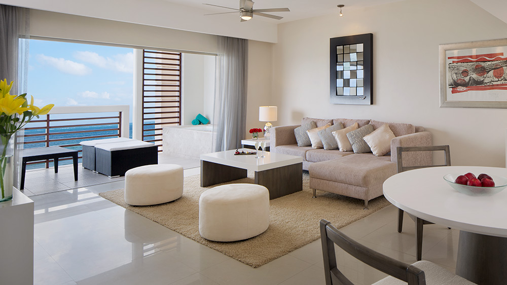 Living room of the Preferred Club Honeymoon Suite at Secrets Silversands