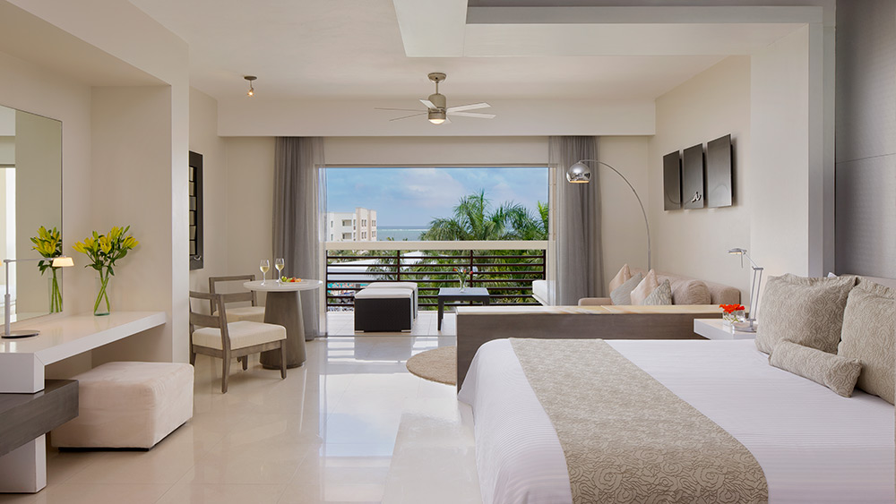 Bedroom of the Preferred Club Junior Suite Pool View at Secrets Silversands