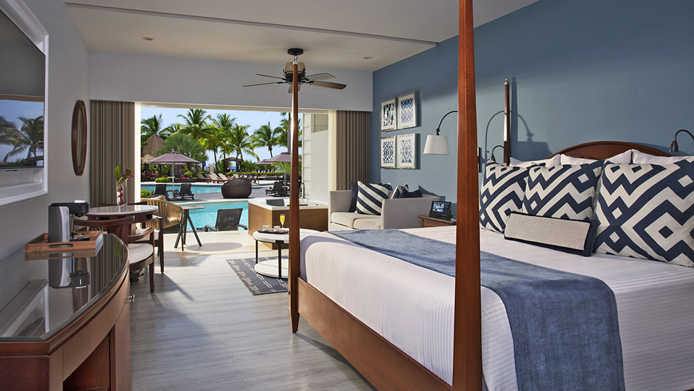 Bedroom of the Preferred Club Junior Suite Swim Out at Secrets St James