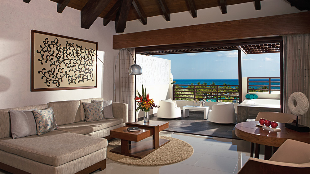 Living room of the Preferred Club Rooftop Jacuzzi Ocean View Suite at Secrets Silversands