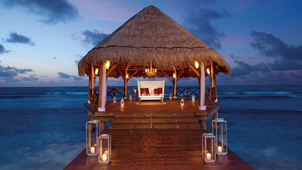 Private dining in a gazebo at sunset at Secrets Silversands Riviera