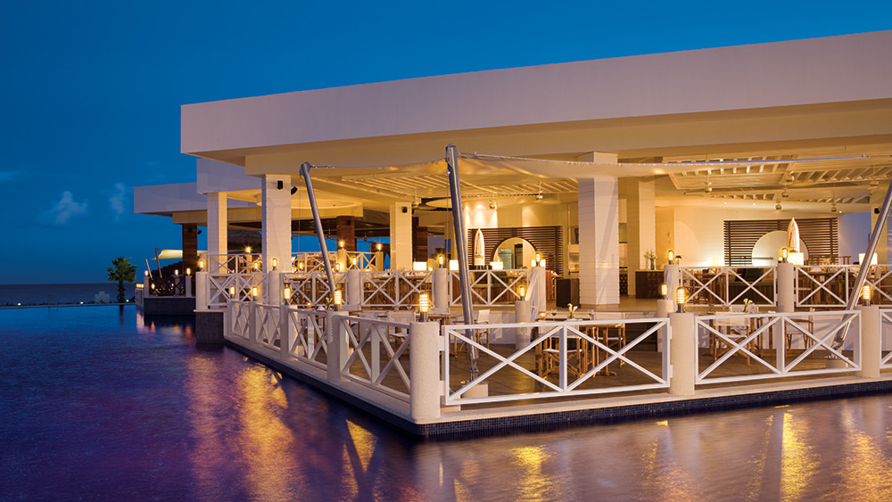 Outdoor night dining at Seaside Grill at Secrets Silversands Riviera