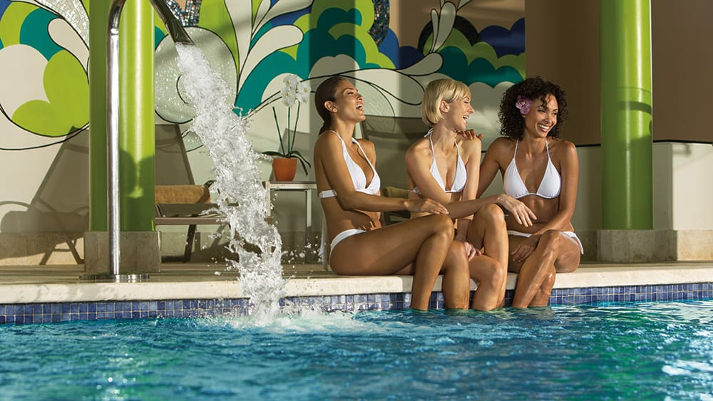 Girlfriends on the edge of the spa pool at Breathless Punta Cana