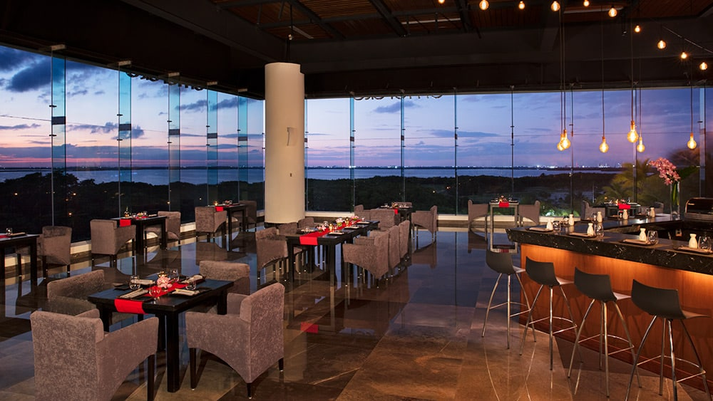 Indoor dining at Spice Restaurant at sunset at Now Emerald
