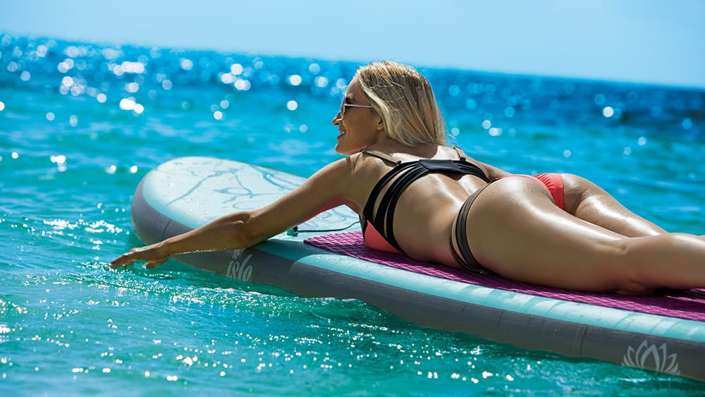 Woman on a surfboard at Breathless Riviera Cancun