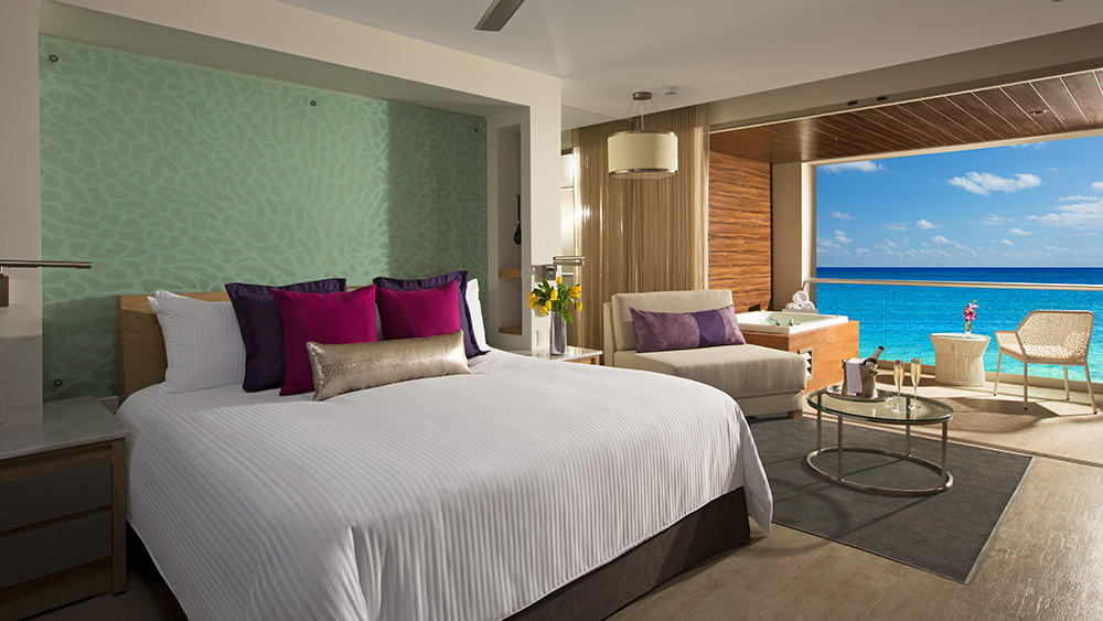 Bedroom of the Xhale Club Junior Suite Ocean View at Breathless Riviera Cancun