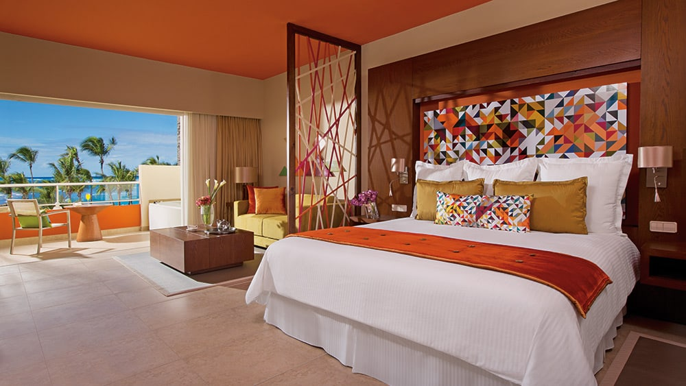 Bedroom of the Xhale Club Junior Suite Pool View at Breathless Punta Cana