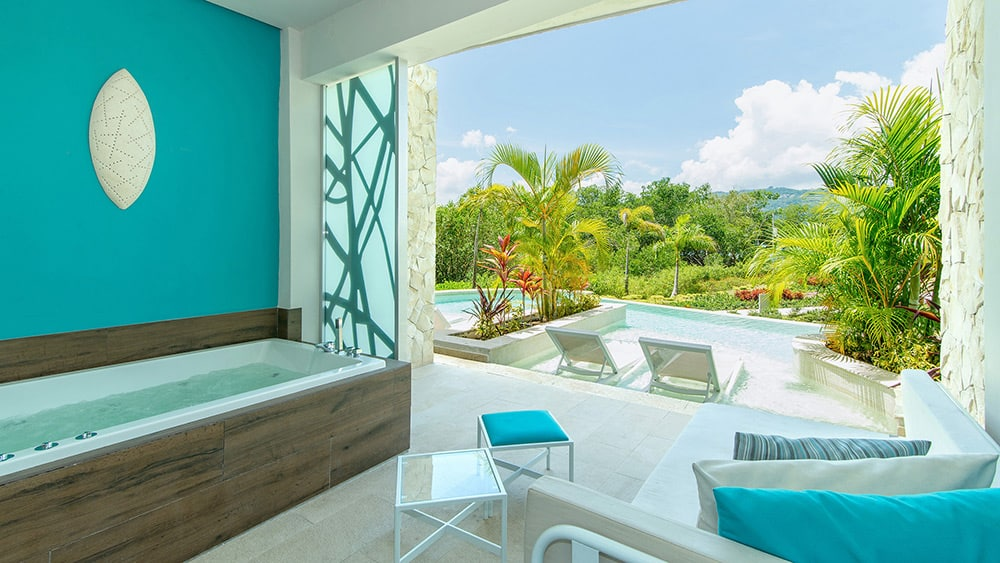 Terrace with direct pool access of the Xhale Club Junior Suite Swim-Up at Breathless Montego Bay