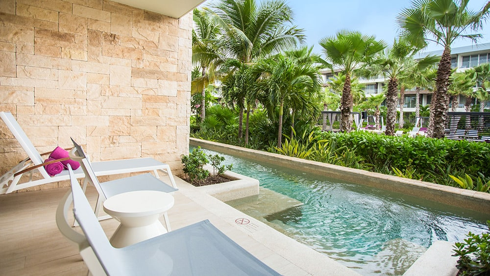 Terrace with pool of the Xhale Club Junior Suite Swimout Tropical View at Breathless Riviera Cancun