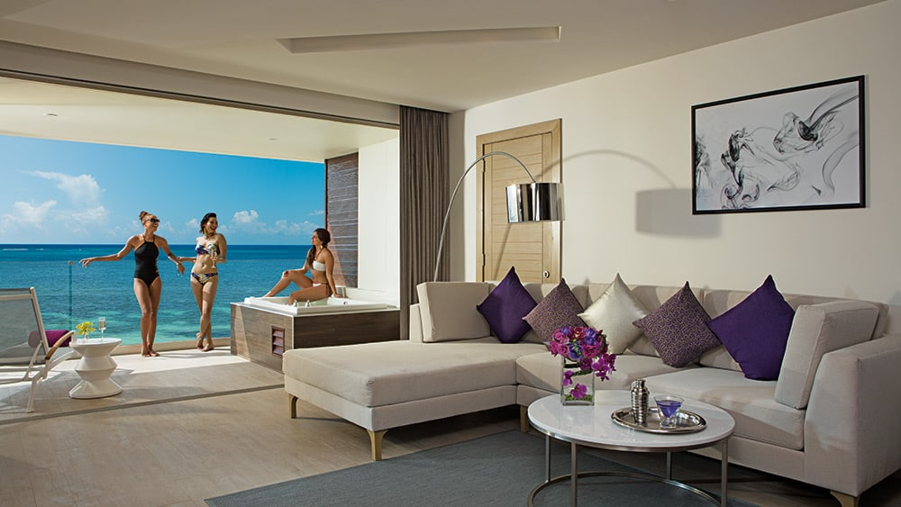 Living room of the Xhale Club Master Suite Ocean View at Breathless Riviera Cancun