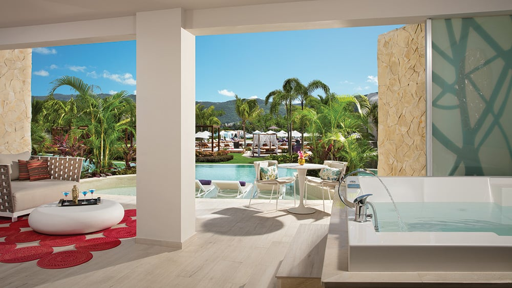 Terrace with direct pool access in the Xhale Club Master Suite Swim-Out at Breathless Montego Bay