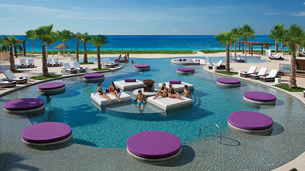 People relaxing in the Xhale Club pool at Breathless Riviera Cancun